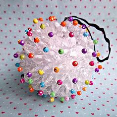 Styrofoam ball, clear faceted beads, colored sparkle beads, head pins, craft  glue