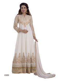This Suit Looks Appealing Owing To The Beautiful Pattern And Its Vibrant Color Combination. This Suit Has Embroidery Work On The Neck Line With Lower Part. The Copper Colored Zari Border. The Off White Colored Top Is Fabricated In Georgette, While The Bottom And Inner Is Made Of Santoon Fabric. The Najneen Chiffon Fabric Dupatta. This Stylish Suit Just For You. http://www.addsharesale.com/