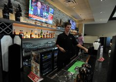 Bartender Zach Roozeboom works at the bar at the Hy-Vee Market Cafe in West Hy-Vee on Thursday in Ames. Photo by Nirmalendu Majumdar/Ames Tribune