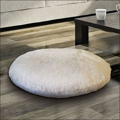 M. Kennedy Home Polar Faux Fur Floor Cushion For those who are no strangers to circling up and eating dinner at their coffee table, perching on this fluffy faux-fur pillow is far more preferable to kneeling on the hardwood.