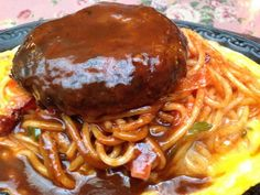 Japanese take on western food: rissoles, napolitan spaghetti on top of an omelette