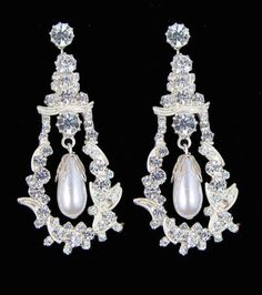 Diamond and Pearl-drop earrings of Queen Mary-(all jewels either for her private collection or part of the Crown Jewels of the UK)