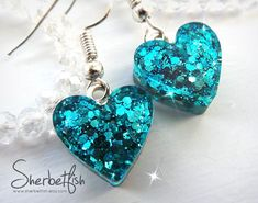 Heart shaped resin earrings by artist SherbetFish. Sparkles shimmer and shine within bright turquoise resin giving an eyecatching pair of earrings. Cute Jewelry, Diy Jewelry, Handmade Jewelry, Jewelry Design, Women Jewelry, Making Resin Jewellery, Diy Resin Crafts, Bijoux Diy, Heart Earrings