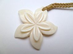 This is a beautifully hand-crafted pendant made of natural buffalo bone in a traditional flower design. Brown braided cotton necklace has an adjustable sliding knot to adjust the necklace into any desirable length. Sculpture Sur Os, Jewelry Shop, Jewelry Making, Wood Carving Designs, Sliding Knot, Bone Carving, Modern Jewelry, Flower Designs, Jewelery