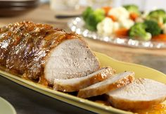 Pork roast slow-cooks to tenderness under a tangy glaze of apricot preserves, mustard, and onion. This is a dish worth waiting for!