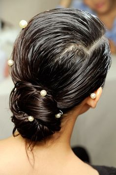 Idea for when my hair is wet and I have to leave the house!   CHANEL - Wet-look chignons adorned with pretty pearls.