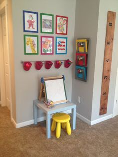 Kid art station {hanging baskets for supplies & magnetic folder racks on wall for paper)