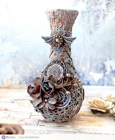 Size: 6.5 x 3 inch (16.5 x 8 cm) This is an original unique Mixed Media altered wooden vase, which I created as Prima Marketing design team member. The vase embellished with 3d elements and a lot of textures. And painted with high quality acrylic metallic paints. Covered with glossy