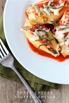 Three Cheese Stuffed Shells - an easy dinner idea your family will love! Includes tips for making ahead and freezing!
