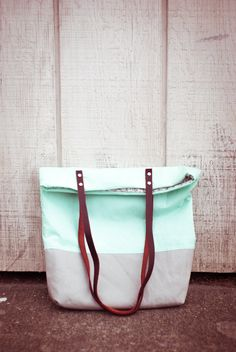 Mint green colorblocked with gray bottom leather handles tote bag. via Etsy.