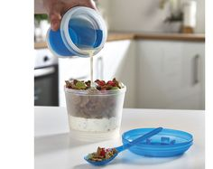 Breakfast On The Go £6  Freezable gel filled bottom container keeps milk, cream and yoghurt cold. Folding spoon snaps into lid. Great for school and ideal for travel. Size 10 x 16 x 3cm. Not microwave safe. Cereal bowl capacity 280ml, milk container capacity. Freezable gel container keeps liquids cold.  Fill with cereal and milk, fruit and yoghurt etc. for on the go breakfast and lunch.  Keeps liquids and solids separate to prevent soggy food. Folding spoon fits in lid  KLife Kleeneze