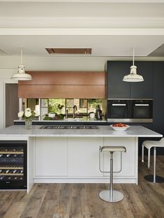 This gorgeous, bespoke Roundhouse kitchen is all in the details; from the Patinated Bronze cabinet, to the mirror splashback and Carrara marble worktop Copper Kitchen, Kitchen Redo, New Kitchen, Kitchen Remodel, Kitchen Design, Kitchen Ideas, Custom Kitchens, Bespoke Kitchens, Cool Kitchens