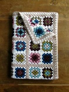 Granny Square Blanket Inspiration by juliette | love the combo of white and taupe around the squares