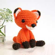 This written crochet pattern includes all the instructions needed to make your own small amigurumi fox in a sitting position.