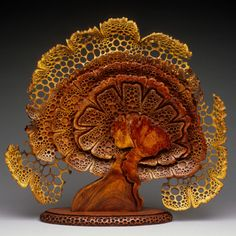 """Mark Doolittle,  Blooming Sculpture Dimensions: 24""""h x 24""""w x 6""""d Carved from one piece of Amboyna Burl with base carved from Bubinga"""