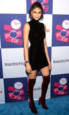 Chanel Iman in a black turtleneck mini dress and thigh-high velvet boots