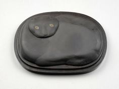 This unusual cat shaped ink stone was donated in 1993 by a Mrs Mae-Fun Chen, who was moving from Knaresborough to the seaside in Essex. Her father was an art collector, who had a shop called the 'Chinese Art Gallery' and when he died in 1967 she selected this ink stone, amongst a few other items, to keep. It is currently on show in the China Cabinet display at the far end of the Servant's Quarters at Lotherton Hall.
