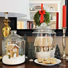 "Keep your freshly decorated gingerbread houses looking their best all season long by displaying them in pretty glass containers. Simply place the finished and dried houses on top of granulated sugar ""snow"" and show off on a side table, mantel, or down the center of a table. Total cost: $10 each"