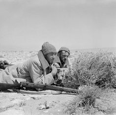 Two men of an LRDG (Long Range Desert Group) patrol on a road watch in North Africa, 25 May 1942