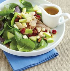 Our Fall Harvest Salad features toasted sugared pecans and a ginger-orange vinaigrette tossed with chicken, apples, cranberries and greens.