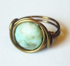 Boho Jewelry - Turquoise Ring, Wire Wrapped Antique Brass Ring. $11.00, via Etsy.