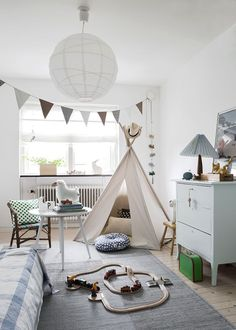 The soft blues and greens in a kid's room