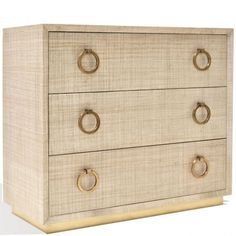 This charming Chest of drawer is manteled with raffia fabric and protected by a thin coat of flat lacquer to protect its from fingerprints or smudge. The drawers are made from mahogany wood and beautifully finished with a soft-topcoat. The polished brass ring-handles give this piece a sophisticated yet natural look.  Size: W 39 x D 17 x H 34 inches