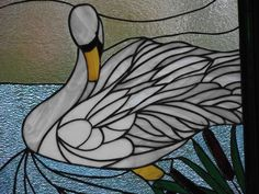 This is my own stained glass at the lake of our trumpeter swans we watch raise their young (cygnets) each year.