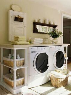 Laundry Rooms We Love - LOVE THIS LOOK!!  Quaint and organized..I need a hanging rod and a bit more storage space however...
