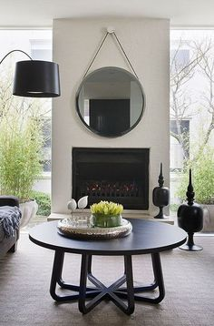 Simple mirror above fireplace