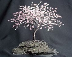 A neat wire cherry blossom tree.    My mother made these all the time and I made a copper orange tree in high school art class! They're actually really easy to make!                                                                                                                                                                                 More