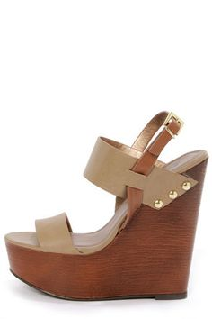 Check it out from Lulus.com! Hey hot stuff, show 'em what's cookin' in your pipin' hot Soda Chef Stone Taupe Wooden Platform Wedge Sandals! Two thick bands of taupe vegan leather form a flawless split upper, with golden rivet detailing along the sides, plus a light brown slingback that adjusts with a golden buckle. 1.75