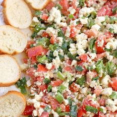 Easy Feta Dip  – a crowd pleasing appetizer that can be prepared in minutes. Serve with warm sliced baguettes for scooping up the dip. Yum!