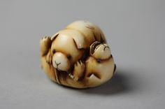 Netsuke of Puppies at Play Period: Meiji period (1868–1912) Date: late 19th century Culture: Japan Medium: Ivory