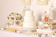 Classic white dessert buffet with a variety of desserts on romantic dishes and plates (Cake by Lovely Cakes)