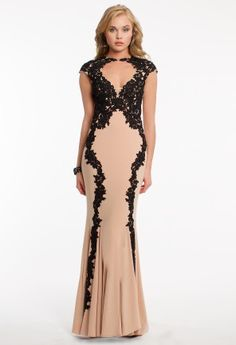 Two-tone lace prom dresses are the hottest trend this season! All you'll need to have an amazing time on your prom night is this gorgeous contrast applique formal dress! With lace cap sleeves, a keyhole v-neckline, lace details, and an illusion back you'll be looking like you've just stepped off the runway! This ultra glamorous prom dress is a long jersey gown that also features a soft trumpet skirt, giving you a flawless silhouette for your special night! Pair it with black heels, a pretty…