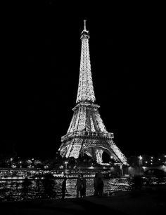 The Eiffel tower. Note that it's not just a photo of the tower, its a photo of the tower, it's lights, and shilouettes of the people walking by it, at night, in black and white. All of this together creates a great photograph.
