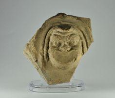 Roman art, Greek comedy mask, Graeco Roman pottery actor mask antefix, 1st century B.C.- 1st century A.D. Roman art, Greek comedy mask, 3.9 cm high. Private collection