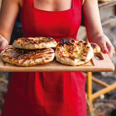 Grilled Pita Bread With Za'atar Recipe (Saveur) | This chewy flatbread topped with za'atar, a spice blend of wild thyme, tangy sumac, and toasted sesame seeds, can be grilled outdoors or oven-baked and finished in a grill pan.