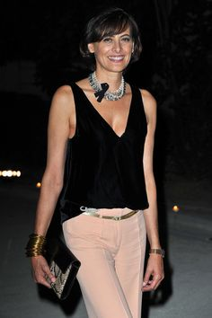 Ines de la Fressange Jewelry - wearing her favorite stacked gold bracelets and a layer of pearl necklaces with a ribbon at the Hogan by Karl Lagerfield Ready to Wear Spring/Summer 2012 Show.