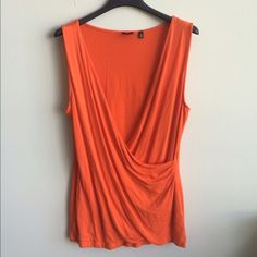 Orange top This is a nice, sleeveless Saks Fifth Avenue top in a size medium. The top is orange in color and free from rips, tears and stains.  I'm only selling and reasonable offers are welcome. Saks Fifth Ave Tops Blouses