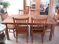 A reclaimed grainery board table with polyurethane spray finish shown with matching chairs.