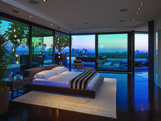 This amazingly open and unique glass encased Master Suite offers gorgeous views of the entire Los Angeles area. 1201 Laurel Way   Beverly Hills