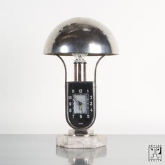 Bed side lamp with integrated alarm clock in Bauhaus Design