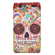 Colorful skull looking face Dia de los Muertos Skull Motorola Droid RAZR Case.  Check out the artist's link.