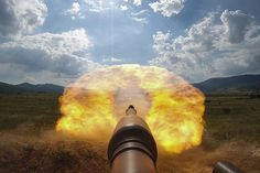 First person view of the blast from the 120mm main gun of an Army M1A2 Abrams tank