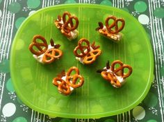 Edible Butterflies: Celery sticks filled with spinach dip, pretzels for wings and raisins for eyes!