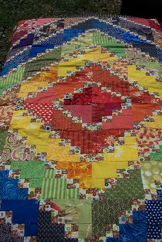 Triple 4-patch rainbow quilt by MimiPark, via Flickr