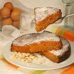 Toucinho Do Céu, translated literally as Bacon from Heaven, is a delicious Portuguese Almond cake originating in the Albufeira region of Portugal. Gourmet Recipes, Baking Recipes, Cake Recipes, Dessert Recipes, Portuguese Desserts, Portuguese Recipes, Portuguese Food, Unique Recipes, Sweet Recipes