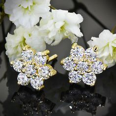 "These ""Flower Cluster"" Diamond Earrings are cast in 14k Yellow Gold and hold 1.00ctw A CUT ABOVE® Hearts and Arrows Diamond Melee."